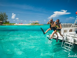 Scuba - couples jump off a boat together in their gear