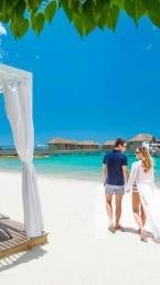 Couple on Beach Cabana Caribbean